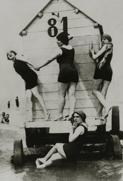 People, Leisure/Holidays, pic: circa 1900's, Four lady bathers dressed in bathing suits of the era, outside a bathing machine at the seaside  (Photo by Popperfoto/Getty Images)